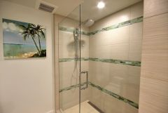 Custom shower with glass tile and linear channel drain