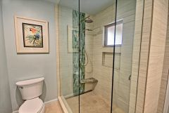 Custom spa shower with floating seat